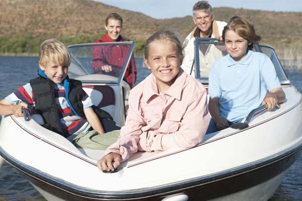 family enjoying a boat ride